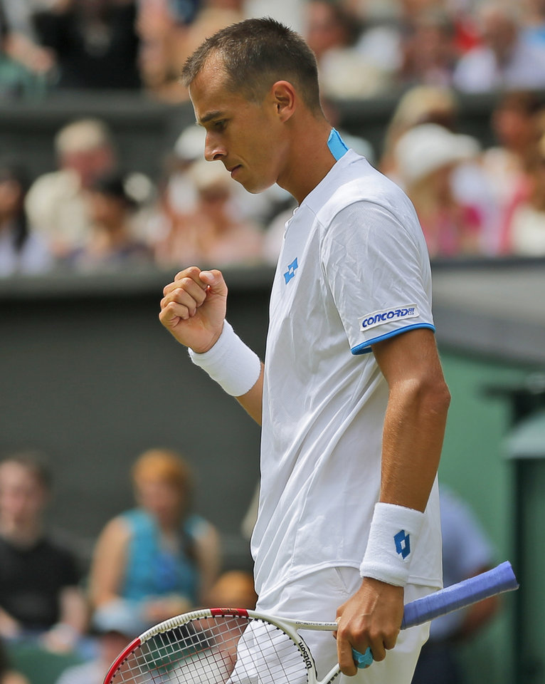 Photo - Lukas Rosol of the Czech Republic celebrates a point during the men's singles match against Rafael Nadal of Spain at the All England Lawn Tennis Championships in Wimbledon, London, Thursday, June 26, 2014. (AP Photo/Pavel Golovkin)