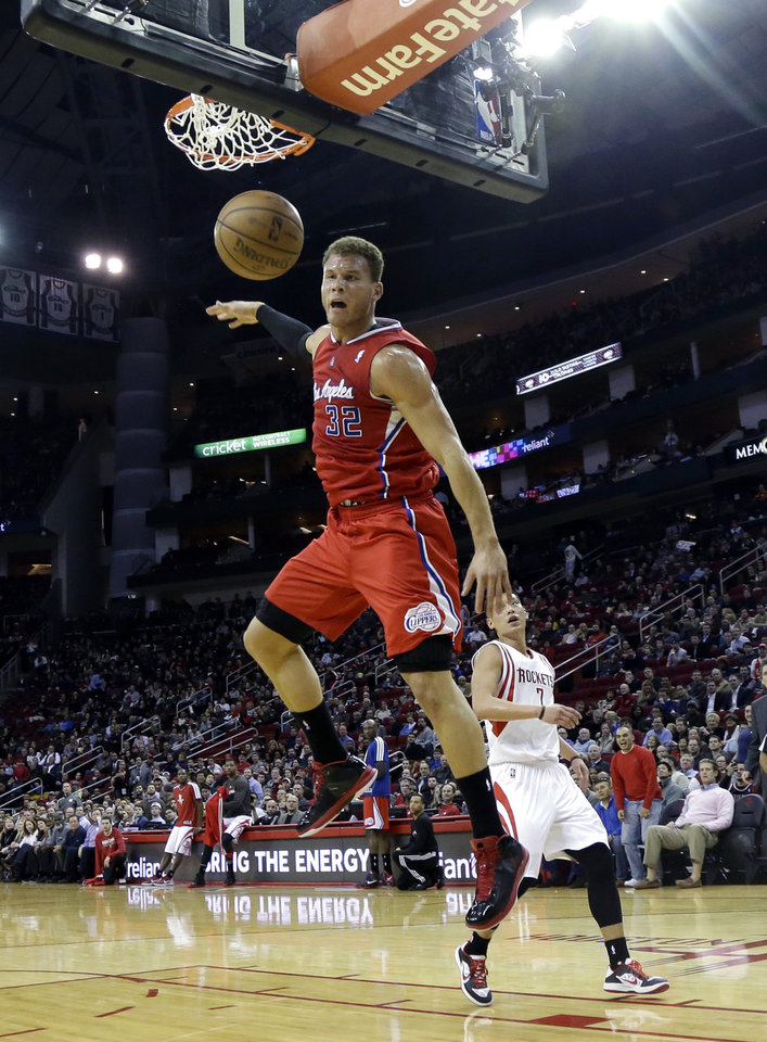 Los Angeles Clippers' Blake Griffin (32) reacts after dunking the ball as Houston Rockets' Jeremy Lin (7) watches during the first half of an NBA basketball game Tuesday, Jan. 15, 2013, in Houston. (AP Photo/David J. Phillip)
