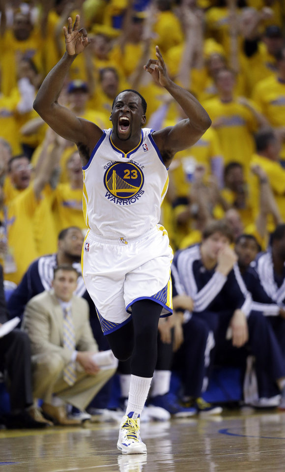 Photo - Golden State Warriors' Draymond Green (23) celebrates after making a three-point basket against the Denver Nuggets during the second half of Game 6 in a first-round NBA basketball playoff series in Oakland, Calif., Thursday, May 2, 2013. Golden State won 92-88. (AP Photo/Marcio Jose Sanchez)