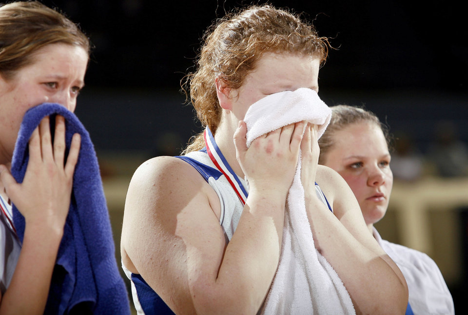 Photo - Cyril's Emily Horn, left, and Shelbi Skaggs react to a loss to Boynton-Moton during the Class B state championship game at State Fair Arena on Saturday. Photo by Sarah Phipps, The Oklahoman