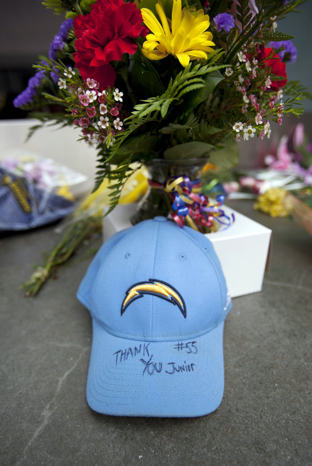 "A San Diego Chargers hat with the words ""Thank you, Junior"" sits in front of the doors of former NFL football player Junior Seau's restaurant, Wednesday, May 2, 2012, in San Diego. The former NFL star was found shot to death at his home in what police said appeared to be a suicide. He was 43. (AP Photo/Gregory Bull)"