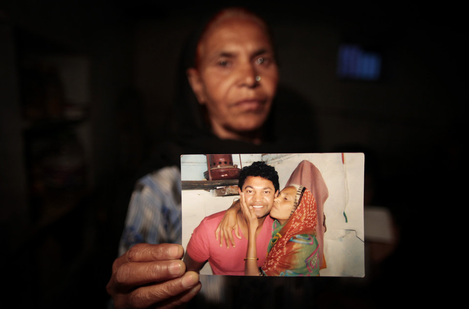Photo -   In this May 10, 2012 photo, Fatima Munshi, mother of Saroo, holds up a photo from their reunion in February 2012 at her home in Khandwa, India. Living in Australia, Saroo Brierley, 30, was reunited with his biological mother, Munshi, 25 years after an ill-fated train ride left him an orphan on the streets of Calcutta. (AP Photo/Saurabh Das)