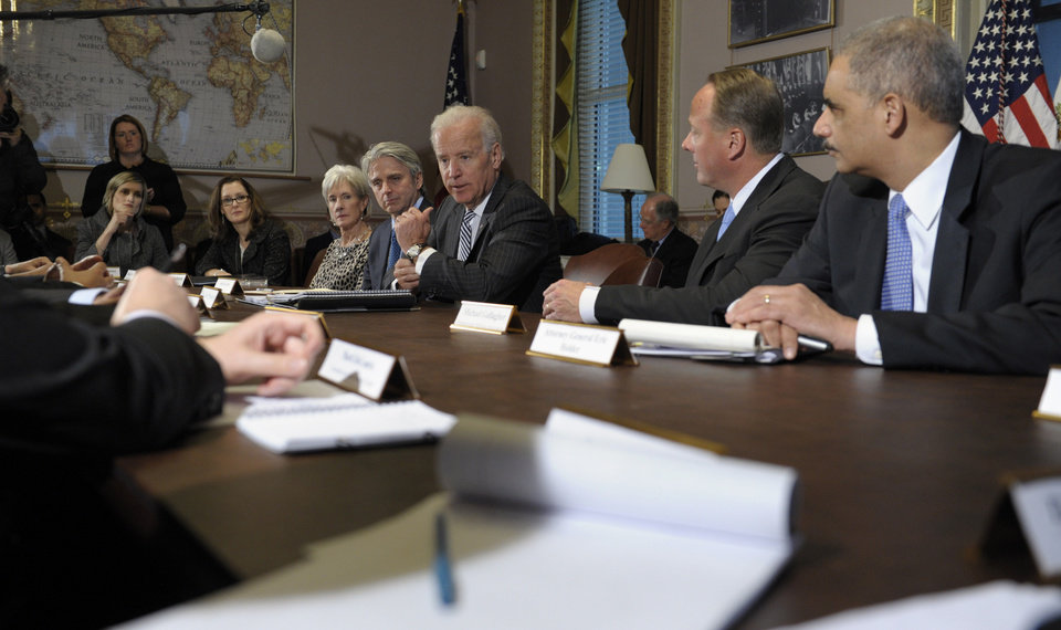 Photo - Vice President Joe Biden, center, speaks during a meeting with representatives from the video game industry in the Eisenhower Executive Office Building on the White House complex in Washington, Friday, Jan. 11, 2013. Biden is holding a series of meetings this week as part of the effort he is leading to develop policy proposals in response to the Newtown, Conn., school shooting. From right to left are, Attorney General Eric Holder, Entertainment Software Association President Michael Gallagher, Biden, Electronic Arts Chief Executive Officer John Riccitiello, and Health and Human Services Secretary Kathleen Sebelius.  (AP Photo/Susan Walsh)