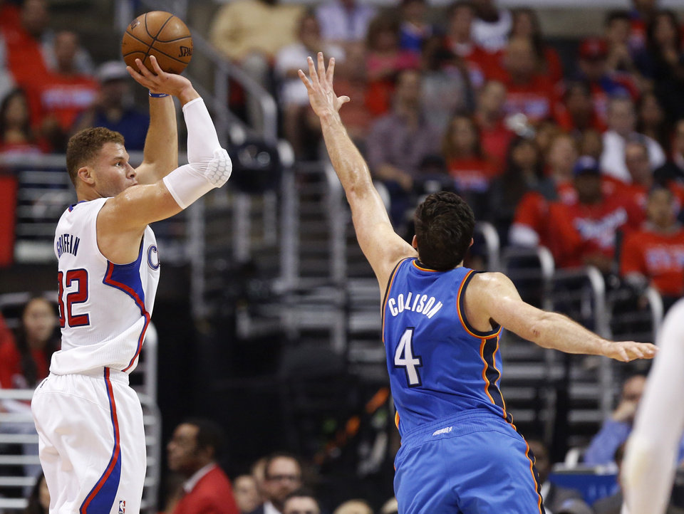 Photo - Los Angeles' Blake Griffin (32) shoots Oklahoma City's Nick Collison (4) defends during Game 3 of the Western Conference semifinals in the NBA playoffs between the Oklahoma City Thunder and the Los Angeles Clippers at the Staples Center in Los Angeles, Friday, May 9, 2014. Photo by Nate Billings, The Oklahoman
