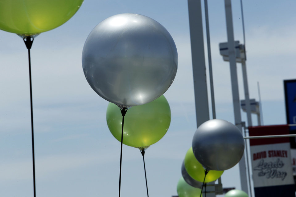 Balloons wave in the wind as car shoppers visit David Stanley Chevrolet on Interstate 240 and Walker Avenue. Dealerships have started to see customers with insurance checks to spend on a new vehicle following May severe weather. <strong>STEVE SISNEY - THE OKLAHOMAN</strong>