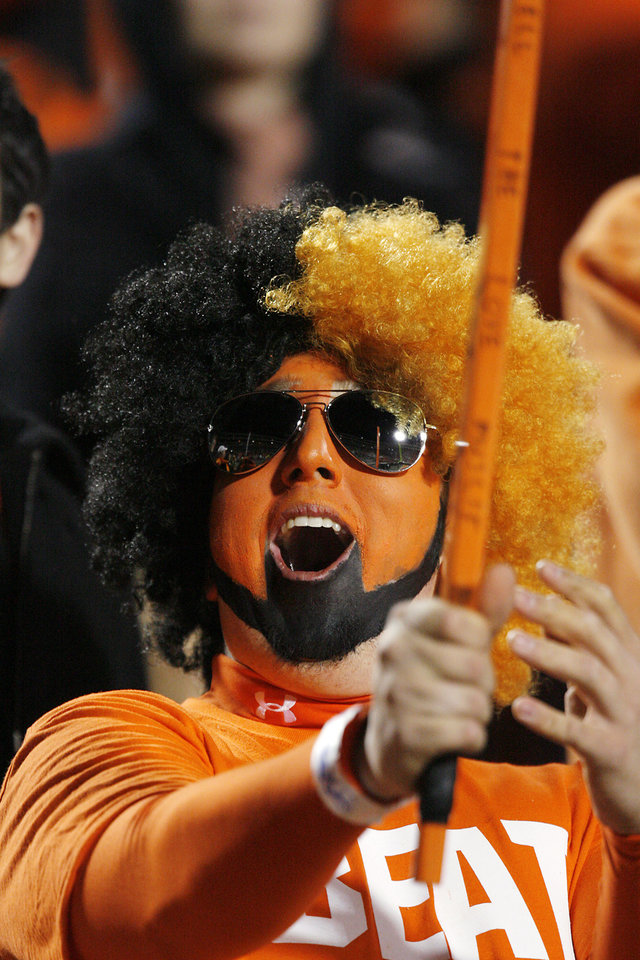 Oklahoma State fan Alex Belitz cheers before the college football game between the University of Oklahoma Sooners (OU) and Oklahoma State University Cowboys (OSU) at Boone Pickens Stadium on Saturday, Nov. 29, 2008, in Stillwater, Okla. STAFF PHOTO BY CHRIS LANDSBERGER