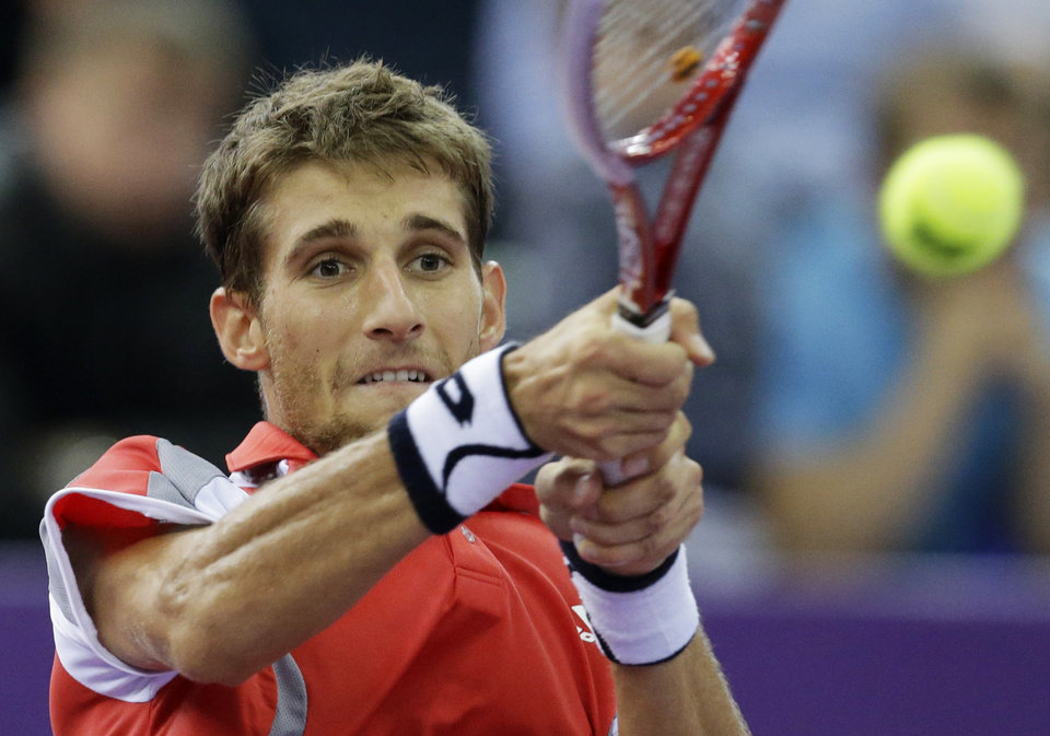 Photo -   Martin Klizan of Slovakia returns the ball to Fabio Fognini of Italy during the St. Petersburg Open ATP tennis tournament final match in St. Petersburg, Russia, Sunday, Sept. 23, 2012. (AP Photo/Dmitry Lovetsky)