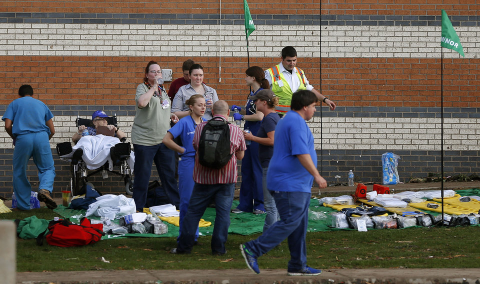 People are treated at a triage area outside the Warren Theatre in Moore, Okla., after a tornado moved through the area on Monday, May 20, 2013. Photo by Bryan Terry, The Oklahoman