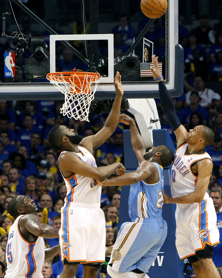 Photo - Oklahoma City's Kendrick Perkins, James Harden and Russell Westbrook combine to stop a shot by Denver's Raymond Felton during the first round NBA Playoff basketball game between the Thunder and the Nuggets at OKC Arena in downtown Oklahoma City on Wednesday, April 20, 2011. The Thunder beat the Nuggets 106-89 and lead the series 2-0. Photo by John Clanton, The Oklahoman