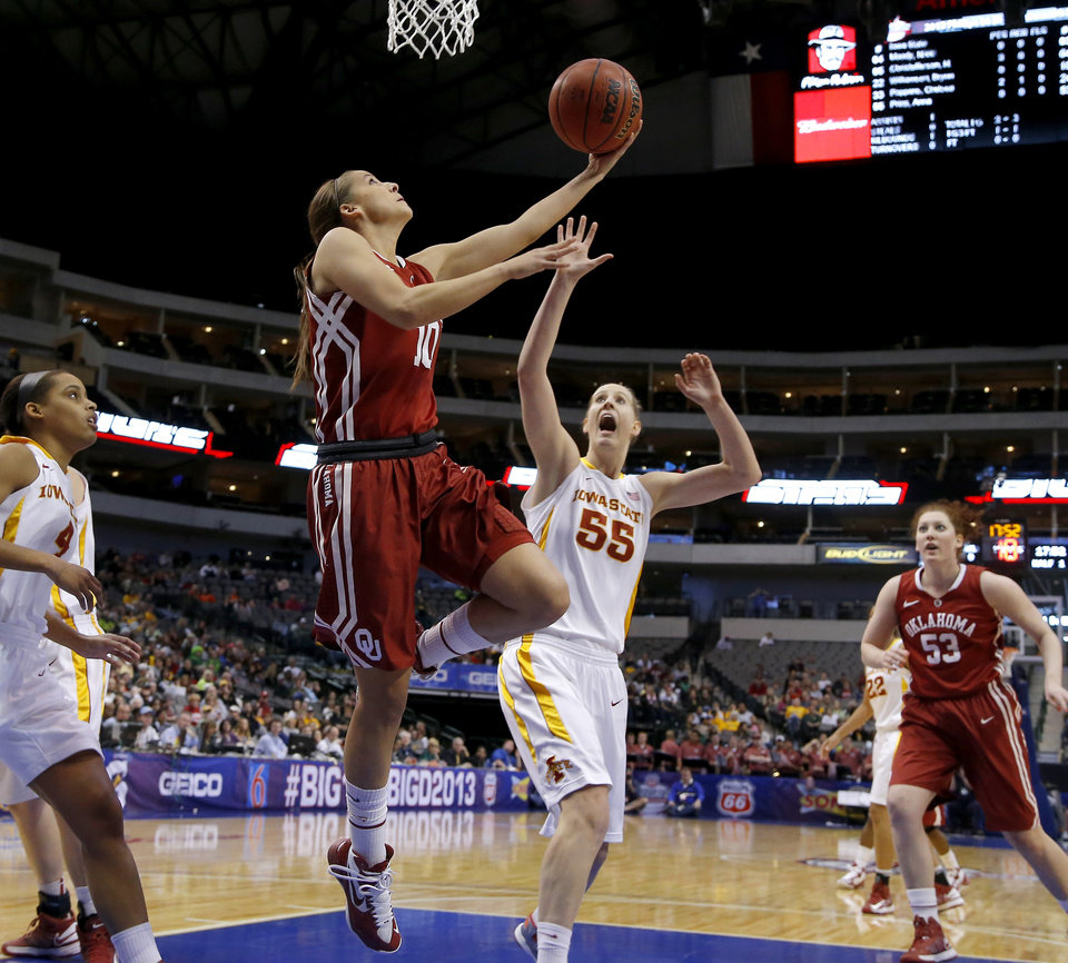 Photo - Oklahoma's Morgan Hook (10) goes to the bask beside Iowa State's Anna Prins (55) during the Big 12 tournament women's college basketball game between the University of Oklahoma and Iowa State University at American Airlines Arena in Dallas, Sunday, March 10, 2012.  Oklahoma lost 79-60. Photo by Bryan Terry, The Oklahoman