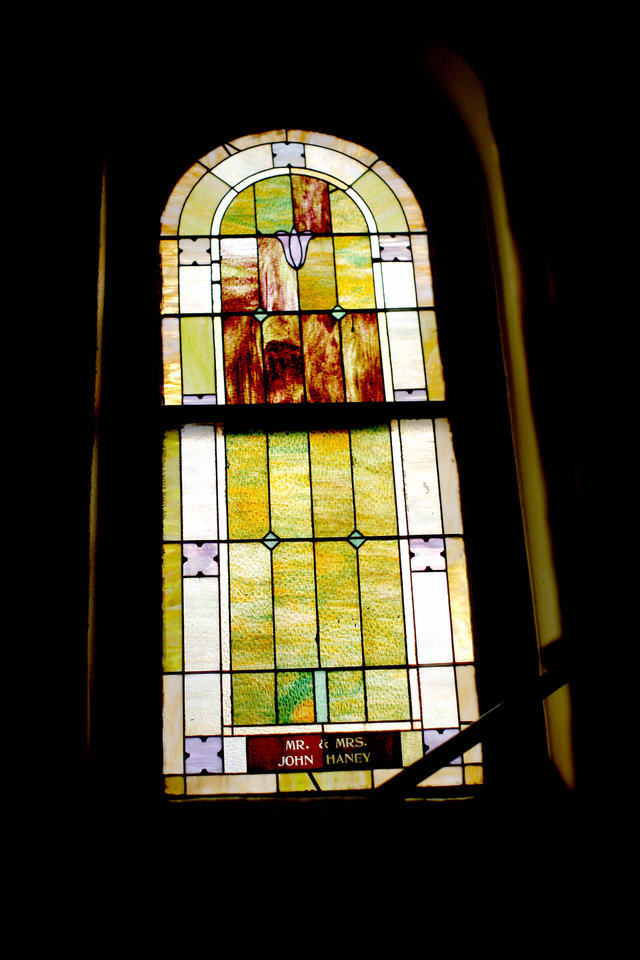 Photo - A stained-glass windows is pictured at the Vernon A.M.E Church in the Greenwood district in Tulsa, Okla., Wednesday, July 29, 2020. Photo by Sarah Phipps, The Oklahoman