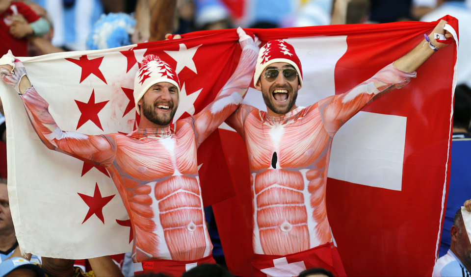Photo - Swiss supporters cheer before the start of the World Cup round of 16 soccer match between Argentina and Switzerland at the Itaquerao Stadium in Sao Paulo, Brazil, Tuesday, July 1, 2014. (AP Photo/Frank Augstein)