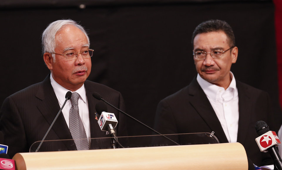 Photo - Malaysia's Prime Minister Najib Razak , left, and acting transport minister Hishammuddin Hussein speak during the press conference for the missing Malaysia Airlines jet, MH370, at Putra World Trade Centre (PWTC) in Kuala Lumpur, Malaysia, Monday, March 24, 2014. Malaysian Prime Minister Najib Razak says a new analysis of satellite data indicates the missing Malaysia Airlines plane plunged into a remote corner of the Indian Ocean. The news is a major breakthrough in the unprecedented two-week struggle to find out what happened to Flight 370, which disappeared shortly after takeoff from Kuala Lumpur to Beijing with 239 passengers and crew aboard on March 8. (AP Photo/Vincent Thian)