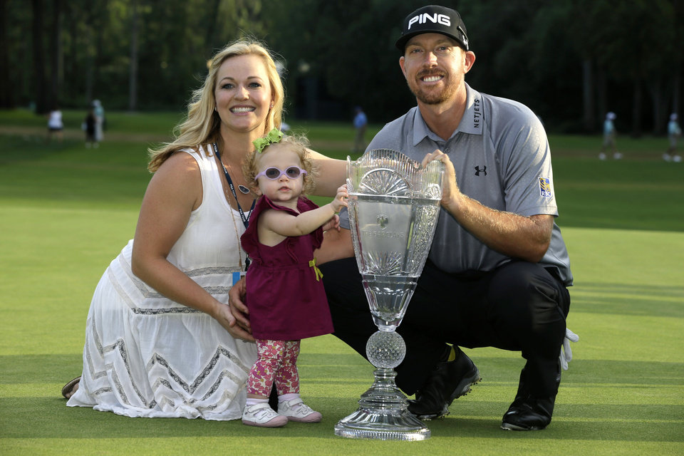 Photo - Hunter Mahan poses with his wife, Kandi and daughter Zoe and the trophy after winning the The Barclays golf tournament Sunday, Aug. 24, 2014, in Paramus, N.J. Mahan won the tournament with a 14 under-par 270.   (AP Photo/Mel Evans)