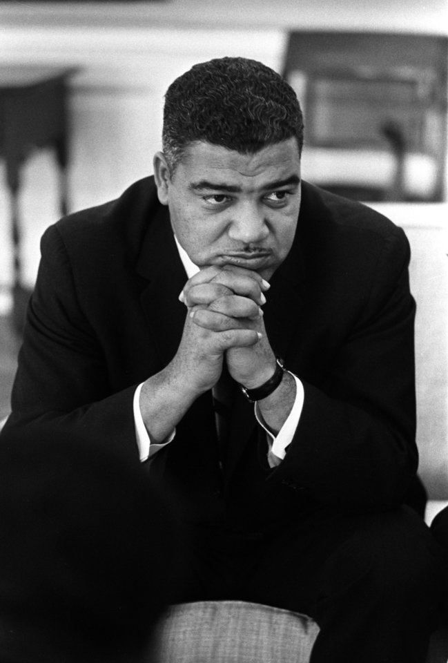 "Photo - This image provided by the LBJ Presidential Library shows Whitney Young during a meeting with President Lyndon Johnson in the Oval Office of the White House in Washington, on Jan. 18, 1964. Rep. John Lewis, D-Ga., tells the story of Young's boldness in dealing with civil rights issues in ""The Powerbroker: Whitney Young's Fight For Civil Rights"" a documentary airing during Black History Month on PBS' Independent Lens and shown in some community theaters. (AP Photo/LBJ Presidential Library, Yoichi Okamoto)"