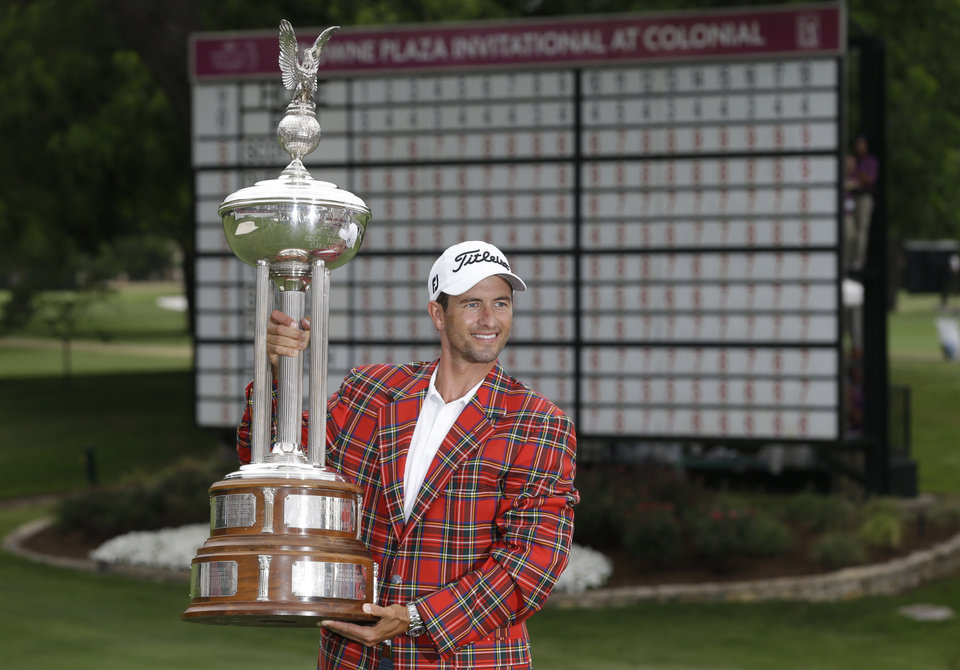 Photo - Adam Scott posses with the champion's trophy after winning the PGA Colonial golf tournament in Fort Worth, Texas, Sunday, May 25, 2014. (AP Photo/LM Otero)