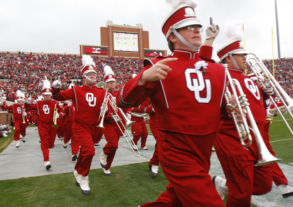 Photo - The Pride of Oklahoma Band take the field before the first half of the college football game between the University of Oklahoma Sooners (OU) and the Oklahoma State University Cowboys (OSU) at the Gaylord Family-Memorial Stadium on Saturday, Nov. 24, 2007, in Norman, Okla. 