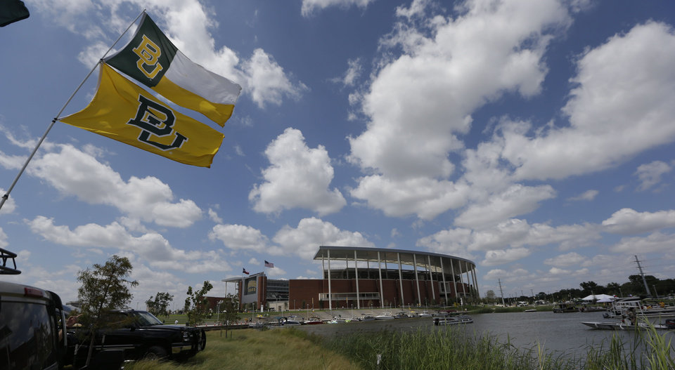 Photo - The Brazos river comes up to the new McLane Stadium before the NCAA college football game between SMU and Baylor, Sunday, Aug. 31, 2014, in Waco, Texas. (AP Photo/LM Otero)