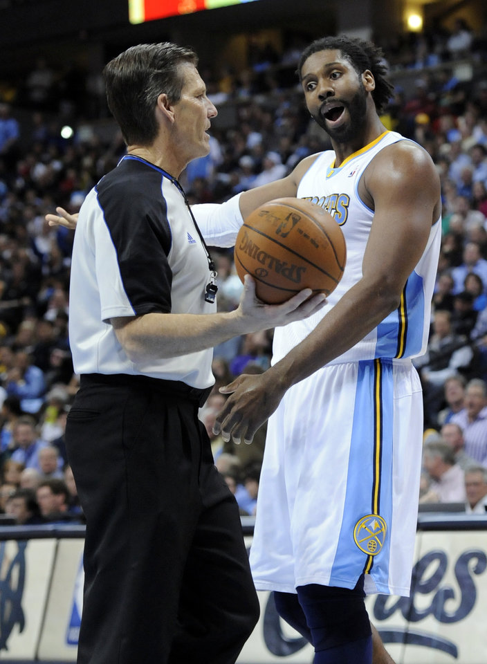 Photo - Denver Nuggets center Nene (31) from Brazil argues with a referee during the first half in game 4 of a first-round NBA basketball playoff series  against the Oklahoma City Thunder Monday, April 25, 2011, in Denver. (AP Photo/Jack Dempsey)
