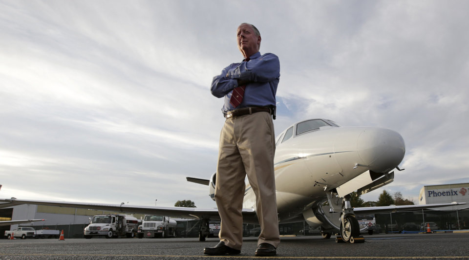"This Thursday, Oct. 25, 2012 photo shows Harvey Martin, a pilot, at the Birmingham Shuttlesworth International Airport in Birmingham, Ala. For 14 months, Martin lived in belt-tightening mode. No new car, no travel, no bolstering his savings, no stock purchases. The corporate pilot lost his job when the Birmingham, Ala., bank where he worked was sold, and the new owners closed the flight department in late 2010. Martin was 55, financially secure, not needing a new job, but definitely wanting one. ""When you lose a job through no fault of your own, it's some consolation,"" he says. ""But that's not much help when you're going to the grocery store."" (AP Photo/Dave Martin)"