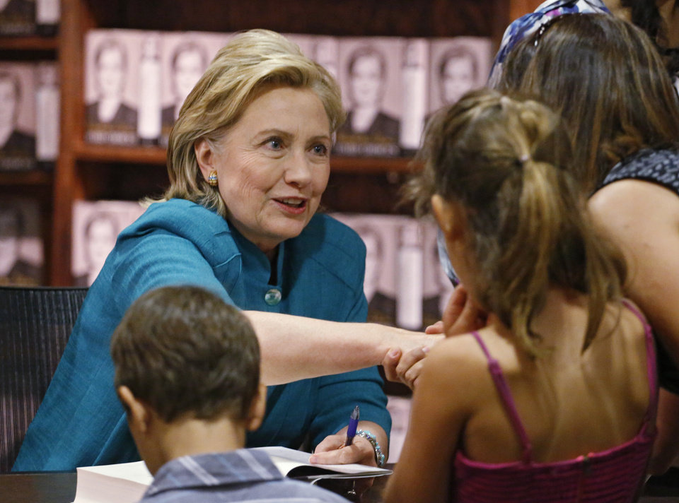 Photo - Former Secretary of State Hillary Rodham Clinton greets fans at a book signing for her new book