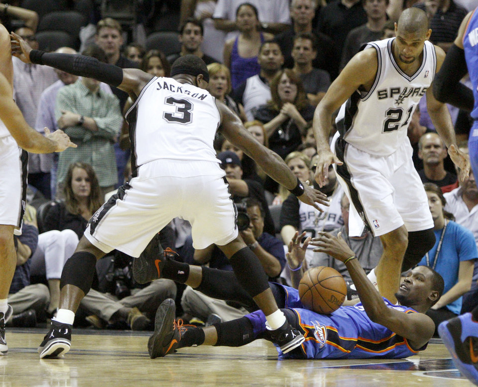 Photo - Oklahoma City's Kevin Durant (35) tries to gain control of the ball under San Antonio's Stephen Jackson (3) and Tim Duncan (21) during Game 1 of the Western Conference Finals between the Oklahoma City Thunder and the San Antonio Spurs in the NBA playoffs at the AT&T Center in San Antonio, Texas, Sunday, May 27, 2012. Oklahoma City lost 101-98. Photo by Bryan Terry, The Oklahoman