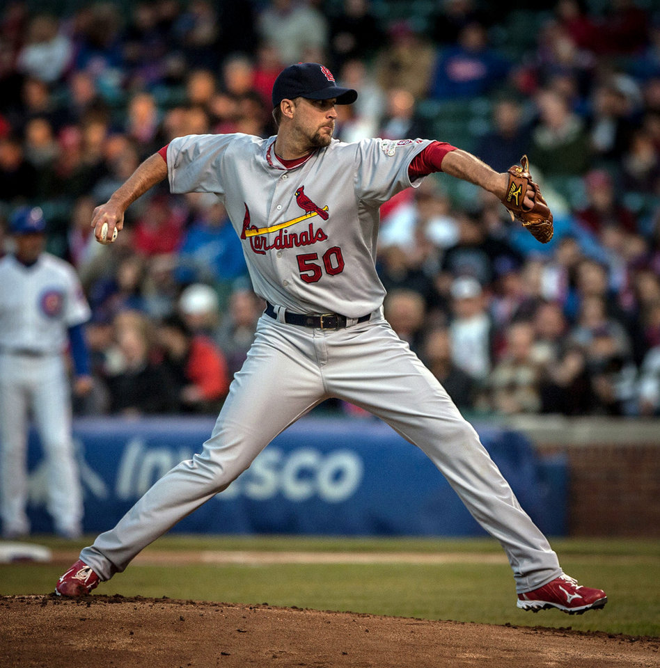 Photo -   St. Louis Cardinals starting pitcher Adam Wainwright throws against the Chicago Cubs in the first inning of a baseball game in Chicago on Tuesday, April 24, 2012. (AP Photo/Charles Cherney)