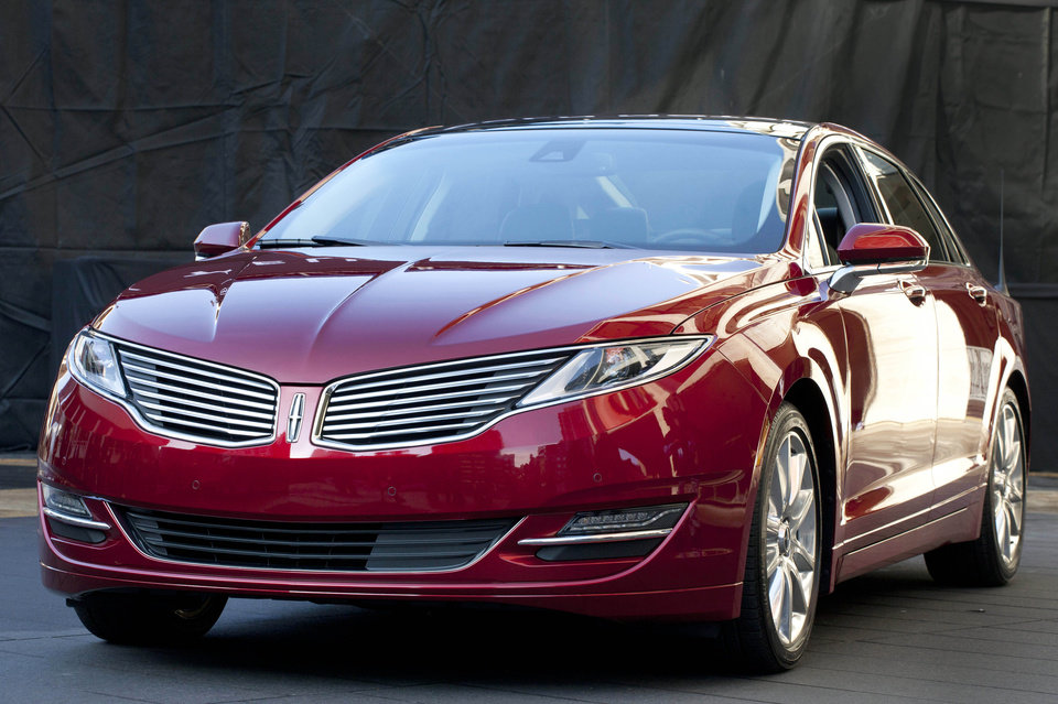 Photo - The Lincoln MKZ is shown at a media availability, Monday, Dec. 3, 2012 in New York. The MKZ will arrive at dealerships this month as the first of seven new or revamped Lincolns that will go on sale by 2015. (AP Photo/Mark Lennihan)