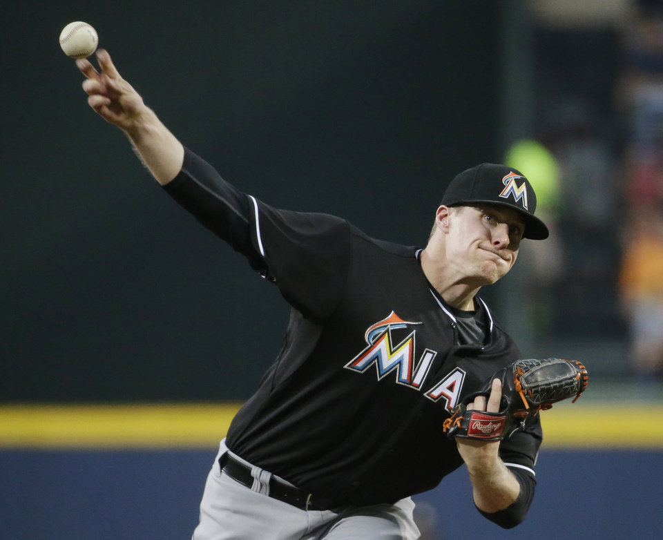 Photo - Miami Marlins starting pitcher Tom Koehler throws in the first inning of a baseball game against the Atlanta Braves, Friday, Aug. 29, 2014, in Atlanta. (AP Photo/David Goldman)
