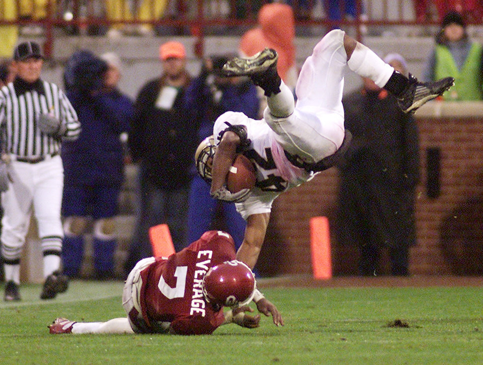 OU: University of Oklahoma college football against University of Colorado in Norman, Okla. Nov. 2, 2002. Brandon Everage upends Bobby Purify in the 4th quarter.  Staff photo by Doug Hoke.