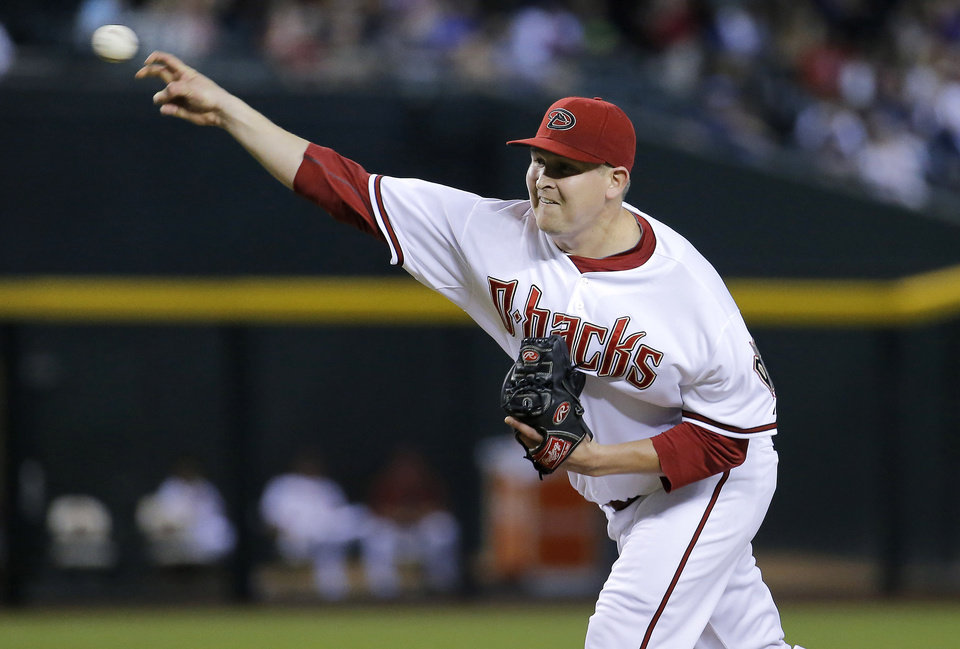Photo - Arizona Diamondbacks pitcher Trevor Cahill throws against the Chicago Cubs during the first inning of a baseball game, Friday, July 18, 2014, in Phoenix. (AP Photo/Matt York)