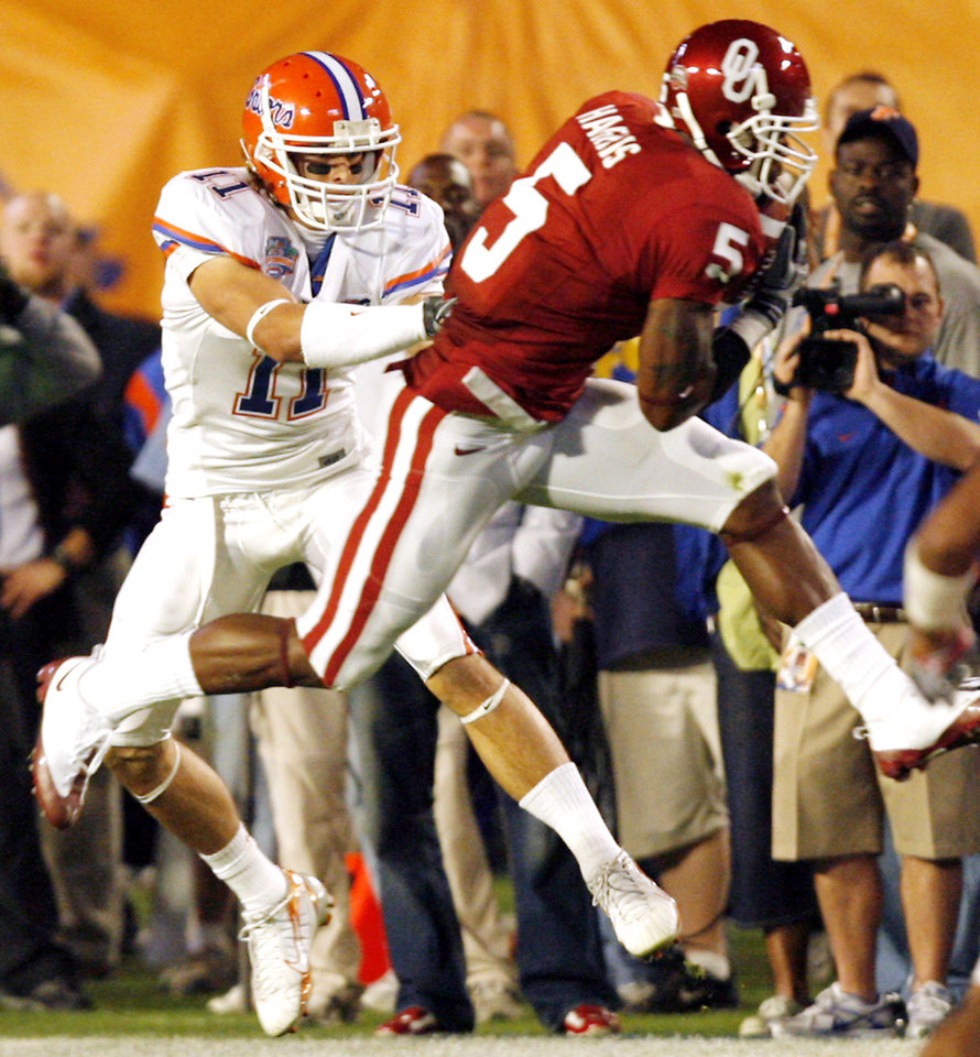Photo - Oklahoma's Nic Harris (5) makes an interception on Florida's Riley Cooper (11) during the first half of the BCS National Championship college football game between the University of Oklahoma Sooners (OU) and the University of Florida Gators (UF) on Thursday, Jan. 8, 2009, at Dolphin Stadium in Miami Gardens, Fla. PHOTO BY CHRIS LANDSBERGER, THE OKLAHOMAN