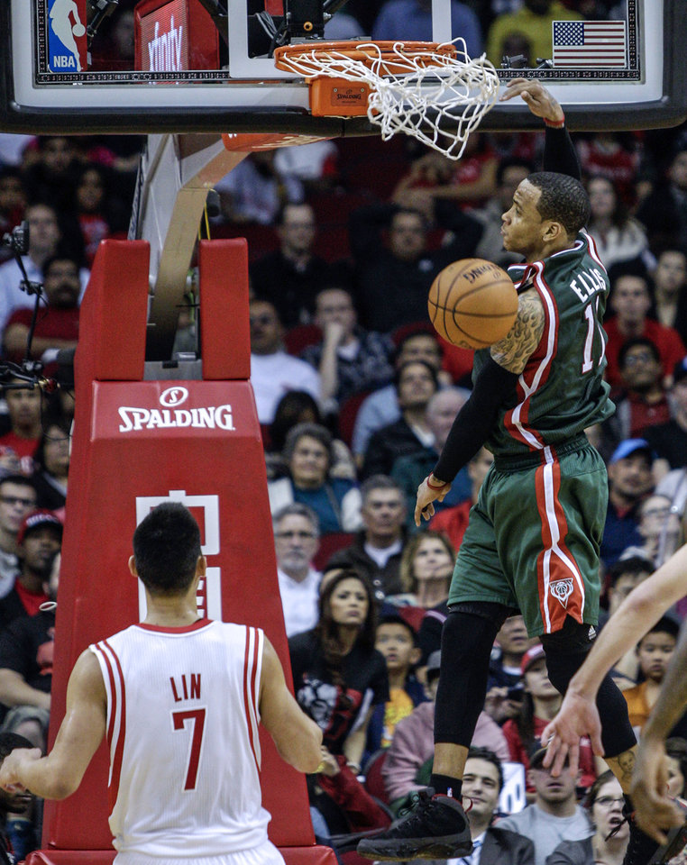 Milwaukee Bucks guard Monta Ellis (11) dunks as Houston Rockets guard Jeremy Lin (7) watches during the second half of an NBA basketball game, Wednesday, Feb. 27, 2013 in Houston. Milwaukee won 110-107. (AP Photo/Bob Levey)
