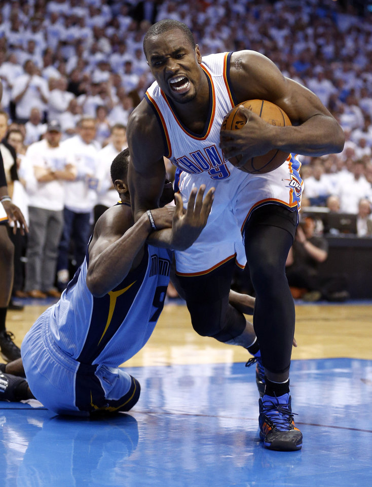 Photo - Oklahoma City's Serge Ibaka (9) gets a loose ball from Memphis' Tony Allen (9) during Game 5 in the first round of the NBA playoffs between the Oklahoma City Thunder and the Memphis Grizzlies at Chesapeake Energy Arena in Oklahoma City, Tuesday, April 29, 2014. Photo by Sarah Phipps, The Oklahoman