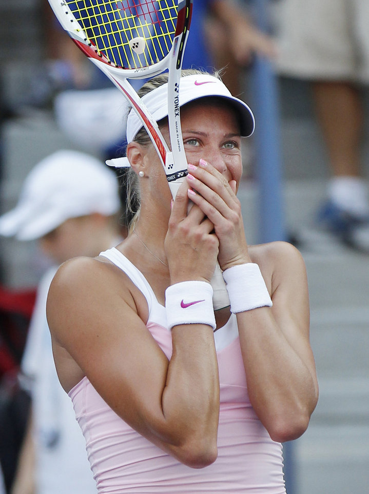 Photo -   Czech Republic's Andrea Hlavackova reacts after winning her match against Russia's Maria Kirilenko in the third round of play at the 2012 US Open tennis tournament, Saturday, Sept. 1, 2012, in New York. (AP Photo/Paul Bereswill)