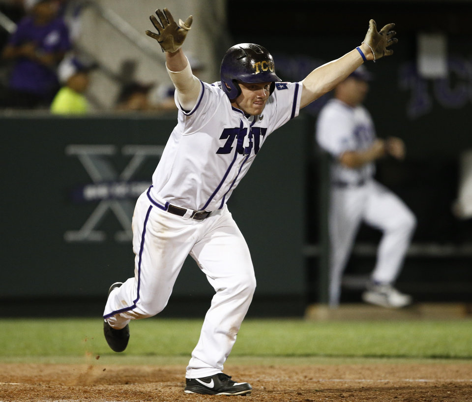 Photo - TCU's Boomer White celebrates his game-winning hit against Siena during the eleventh inning of an NCAA college baseball regional tournament game in Fort Worth, Texas, Friday, May 30, 2014. TCU won in eleven innings 2-1. (AP Photo/Jim Cowsert)
