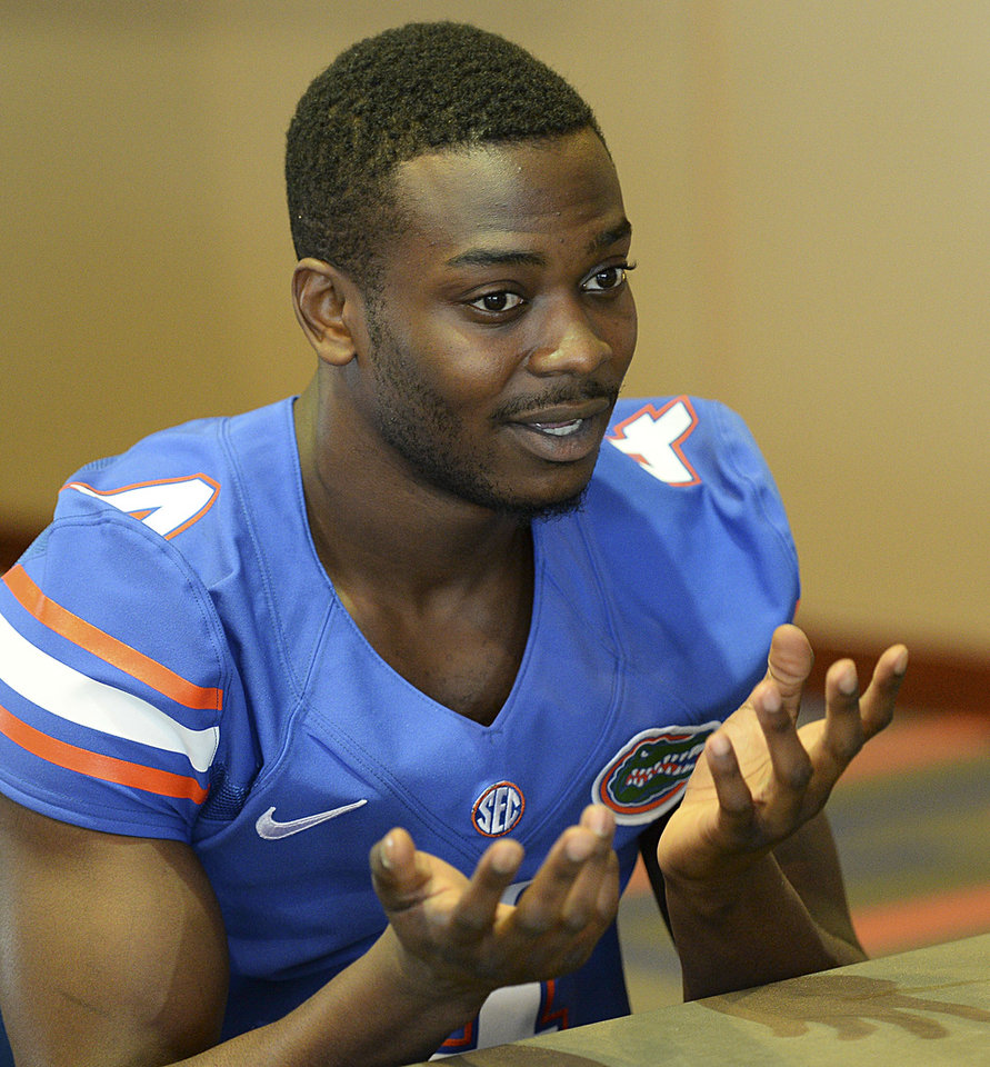 Photo - Florida NCAA college football wide receiver Andre Debose talks with reporters during Media Day in Gainesville, Fla.,  Sunday, Aug. 3, 2014.  (AP Photo/Phil Sandlin)