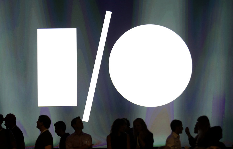 Photo - Attendees of the Google I/O 2014 keynote presentation stand in front of the screen at Moscone Center in San Francisco, Wednesday, June 25, 2014. Google is expected to reveal an Android update, smart home devices and other innovations at its two-day developer conference. (AP Photo/Jeff Chiu)