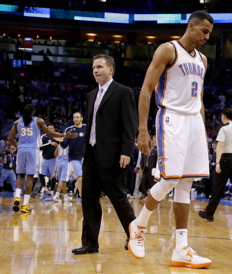 Oklahoma City's Thabo Sefolosha (2) and coach Scott Brooks react during an NBA basketball game between the Oklahoma City Thunder and the Denver Nuggets at Chesapeake Energy Arena in Oklahoma City, Tuesday, March 19, 2013. Denver won 114-104. Photo by Bryan Terry, The Oklahoman