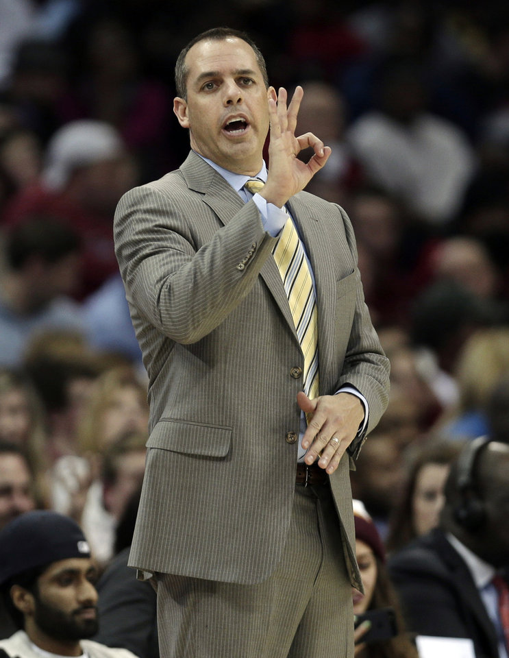 Indiana Pacers head coach Frank Vogel signals to his team during the third quarter of an NBA basketball game against the Cleveland Cavaliers, Friday, Dec. 21, 2012, in Cleveland. The Pacers won 99-89. (AP Photo/Tony Dejak)