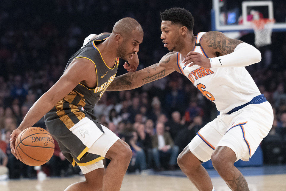 Photo - New York Knicks guard Elfrid Payton (6) guards Oklahoma City Thunder guard Chris Paul during the first half of an NBA basketball game Friday, March 6, 2020, at Madison Square Garden in New York. (AP Photo/Mary Altaffer)