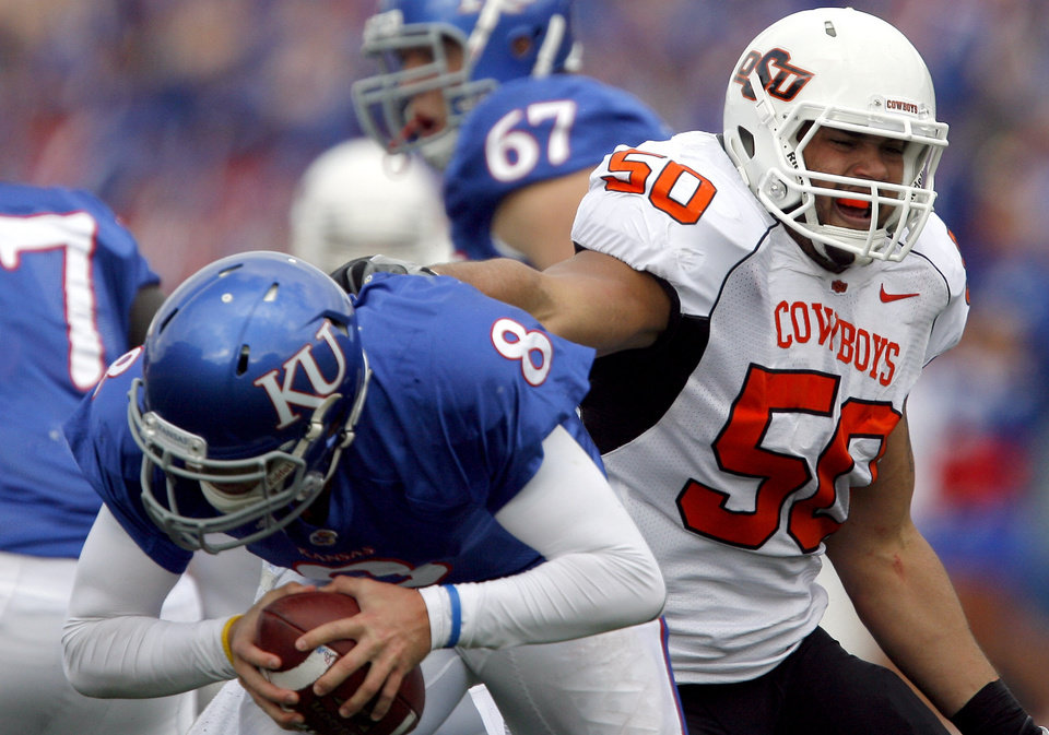 Photo - Oklahoma State's Jamie Blatnick (50) pressures Kansas' Quinn Mecham (8)during the college football game between Oklahoma State (OSU) and Kansas (KU), Saturday, Nov. 20, 2010 at Memorial Stadium in Lawrence, Kan. Photo by Sarah Phipps, The Oklahoman