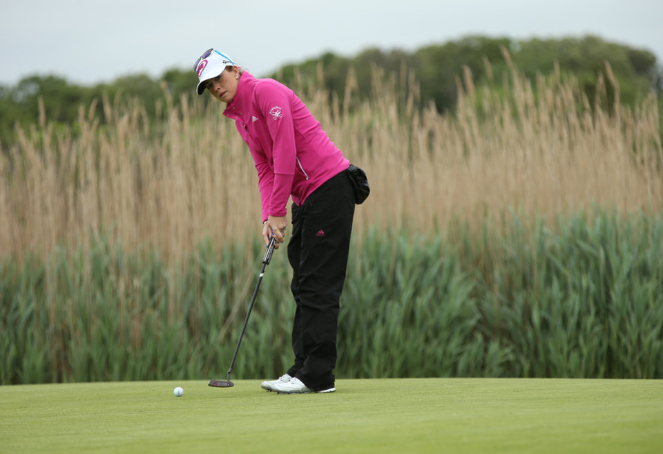 Photo - Paula Creamer putts on the second hole during a pro-am for the Shoprite Classic golf tournament in Galloway, N.J., , Thursday, May 29, 2013. (AP Photo/The Press of Atlantic City, Michael Ein) MANDATORY CREDIT