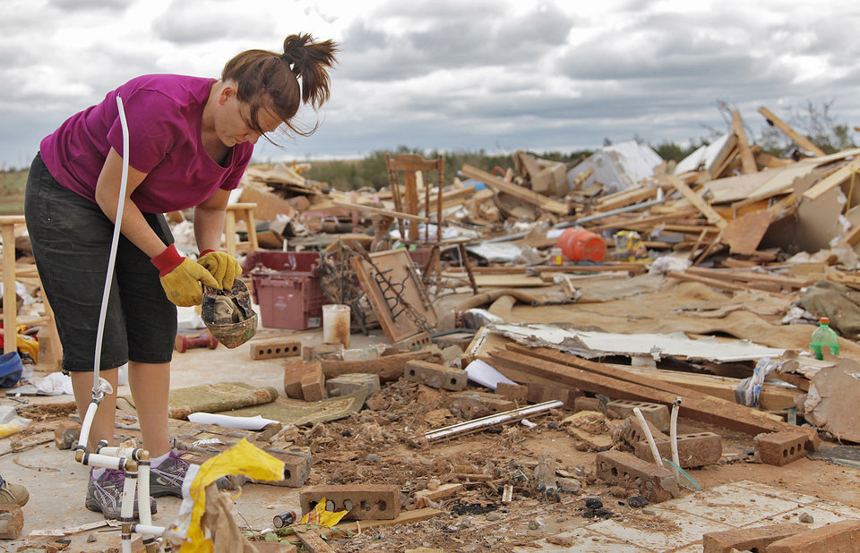 Miranda Lewis tries to recover what items can be salvages from the rubble where her house once stood west of El Reno, Wednesday, May 25, 2011. Photo by Chris Landsberger, The Oklahoman