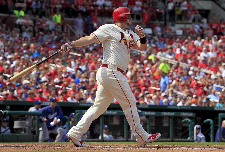 Photo - St. Louis Cardinals' Matt Adams watches his two-run home run during the first inning of a baseball game against the Los Angeles Dodgers Saturday, July 19, 2014, in St. Louis. (AP Photo/Jeff Roberson)