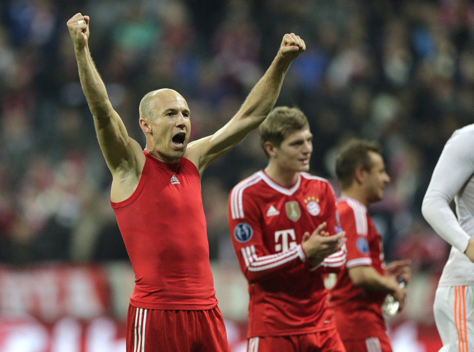 Photo - Bayern's Arjen Robben celebrates at the end of the Champions League quarterfinal second leg soccer match between Bayern Munich and Manchester United in the Allianz Arena in Munich, Germany, Wednesday, April 9, 2014. Bayern won 3-1 to win the tie 4-2 on aggregate. (AP Photo/Matthias Schrader)