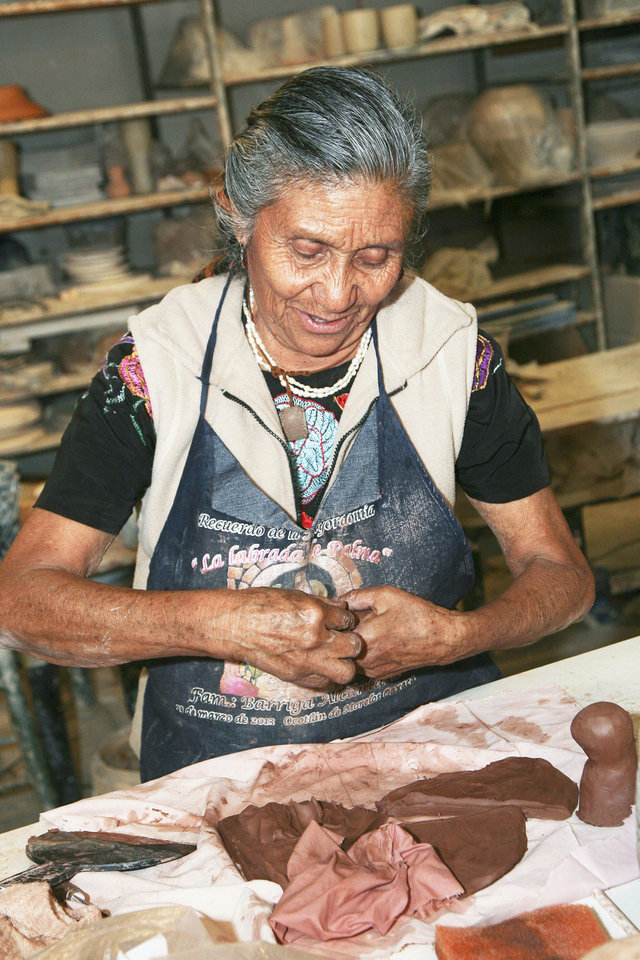 Guillermina Aguilar workis with clay to  make folk art chicken vases. PHOTO BY STEVE MAUPIN, FOR THE OKLAHOMAN    <strong>Copyright Steven N. Maupin</strong>