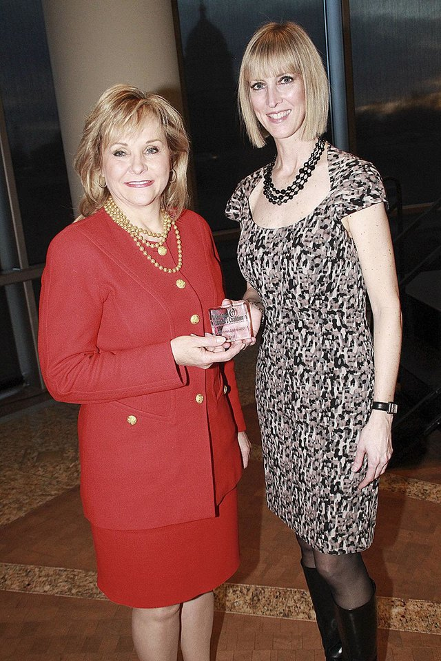 Gov. Mary Fallin accepts the Oklahoma Leading Lady award from Oklahoma Women�s Coalition Executive Director Kristin Davis.  PHOTOS PROVIDED