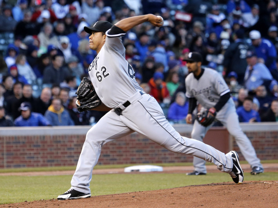 Photo - Chicago White Sox starting pitcher Jose Quintana delivers during the first inning of an interleague baseball game against the Chicago Cubs Monday, May 5, 2014, in Chicago. (AP Photo/Charles Rex Arbogast)