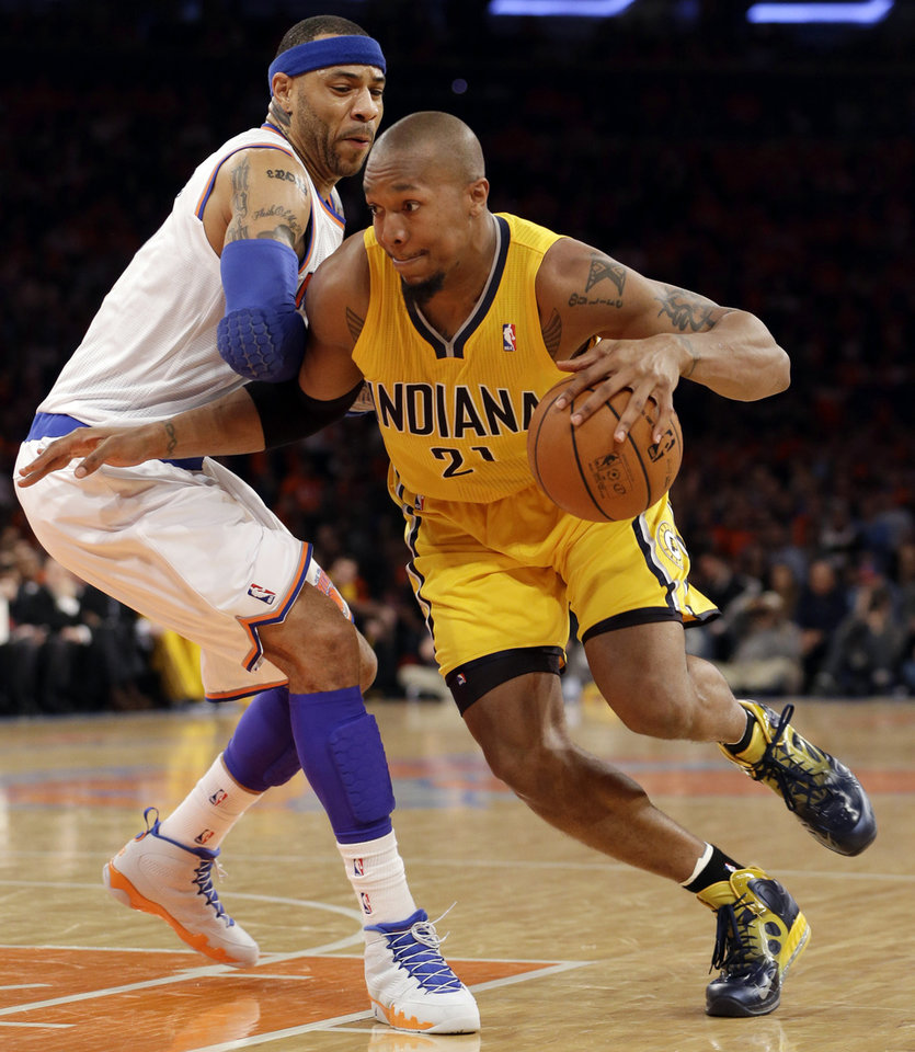 Photo - Indiana Pacers forward David West (21) drives past New York Knicks forward Kenyon Martin (3) in the second quarter of Game 1 of their second-round NBA basketball series at Madison Square Garden in New York, Sunday, May 5, 2013.  (AP Photo/Kathy Willens)